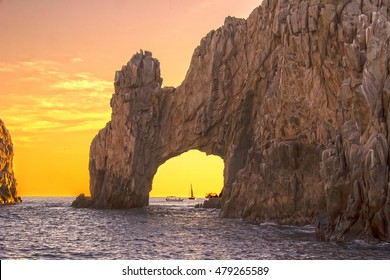 a picture of los cabos arch in a yellow sunset, water  color, blue, yellow, horizontal, location, daylight, nature