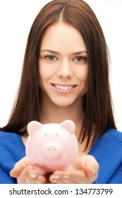 picture of lovely woman with small piggy bank