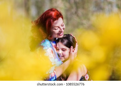 picture of a loving mother who hugs her daughter