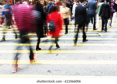 picture made with motion blur of people crossing a street in Hongkong