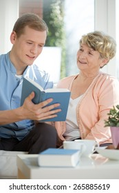 Picture of male caregiver assisting senior woman