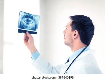picture of male doctor or dentist looking at x-ray