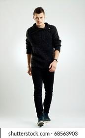 picture of a male fashion model wearing wool sweater, walking