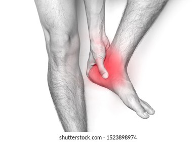 Picture of a male leg And the man's hand, he caught his ankle Pain in the ankle