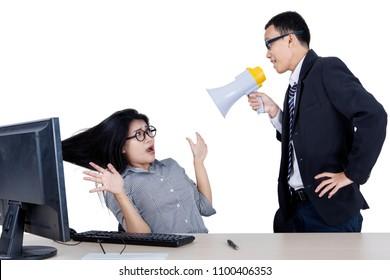 Picture of a male manager looks angry while shouting at his scared employee through a megaphone