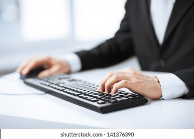 picture of man hands typing on keyboard