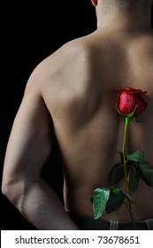 Picture a man  holding a red rose behind his back. Isolated on white background