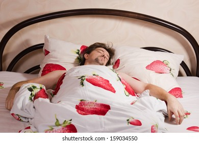 Picture with a man sleeping in bed