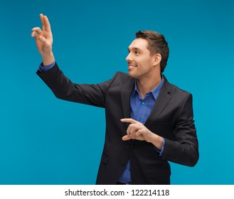 picture of man in suit working with something imaginary.