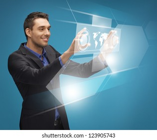 picture of man in suit working with virtual screens