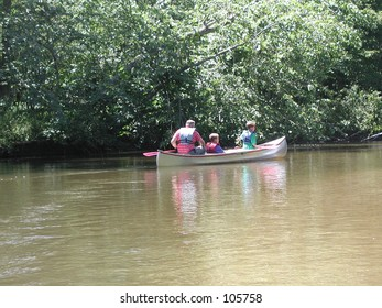 Picture of man and two boys in a canoe
