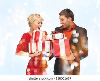 picture of man and woman with gift boxes