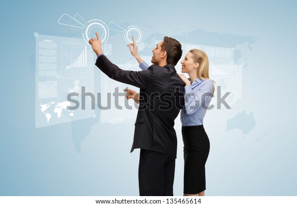 picture of man and woman working with virtual screen