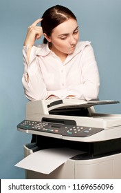 Picture of manager with copier thinking at office