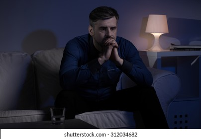 Picture of a miserable man unable to sleep at night