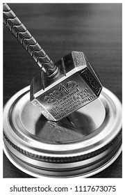 Picture of Mjolnir, Thor's hammer in black and white. The inscription is in English but upside down. It reads: Whosoever holds this hammer, if he be worthy, shall possess the power of Thor