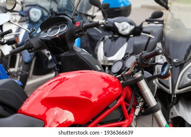 Picture of a modern motor motorbike parked in downtown