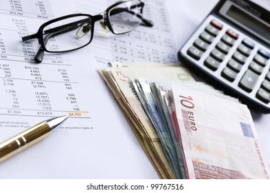 Picture of money, calculator and financial reports