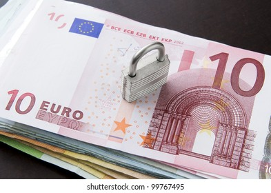 Picture of money stack with key lock on top