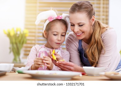 Picture of mother and daughter preparing cookies in the kitchen