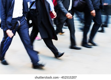 picture in motion blur of walking commuters at rush hour