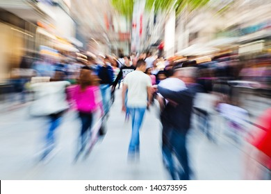 picture of moving people in the pedestrian area of the city with zoom effect