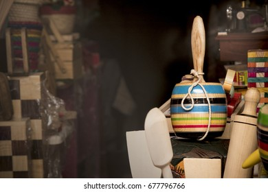 a picture of multicolor balero or cup and ball game, a typical mexican toy and handcraft, taken in a marketplace,
