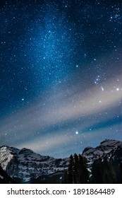 Picture of the night sky, snowy mountains in the background