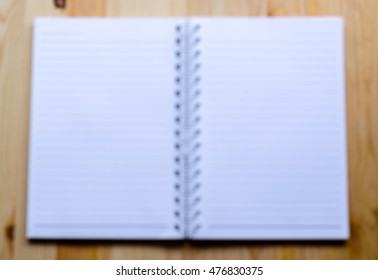 picture of note book paper on wooden background