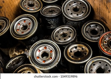 Picture of old car oil filters represented in automobile service center. Old fuel filters of diesel engines.