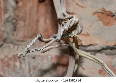 Picture of old electrical aluminum wires connected by twisting.