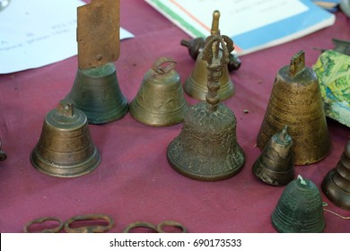 the picture of the old rusty bells on the flea market in albenga