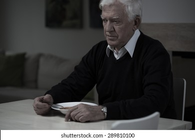 Picture of old, sad man without appetite