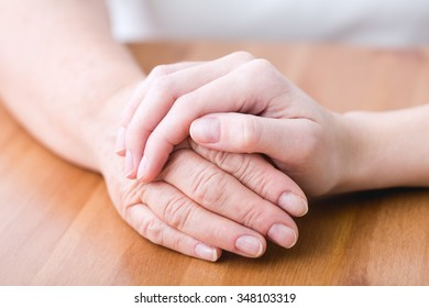 Picture of old sick person having support and help