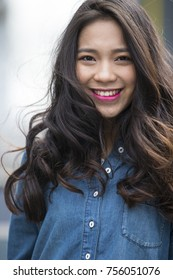 Picture of One beautiful young Chinese woman outdoor in the street