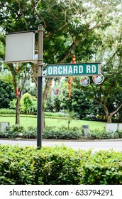 A picture of ORCHARD Street Sign , on of the famous shopping area in SINGAPORE.