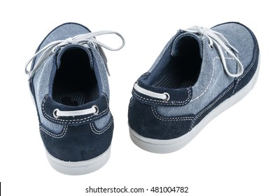 Picture of a pair of blue trainers over a white background. Selective focus.