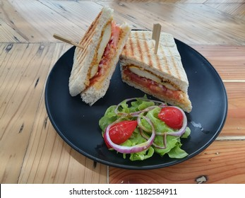 Picture of panini or panino meaning small bread roll is a grilled sandwich made from bread other than sliced bread served with chicken sate and sweet peanut sauce giving Asian taste in western style