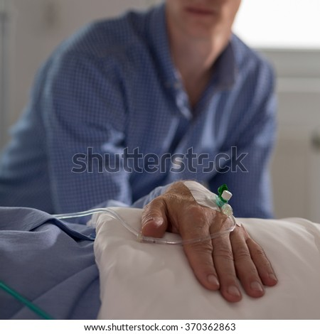 Picture of patient and his relative sitting in the background
