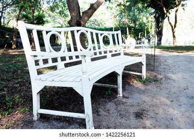 Picture of patio beautiful white chair vintage designed style decorative garden under the green trees comfortably to luxury terrace gazebo - diagonal image copy space