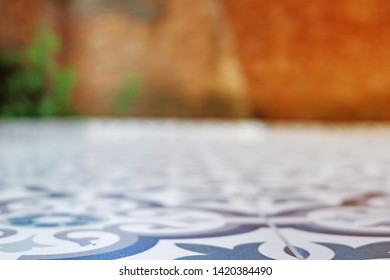 Picture of patio flooring beautiful vintage ceramic blurred background and brownish background with green leaves in the garden next to the kitchen
