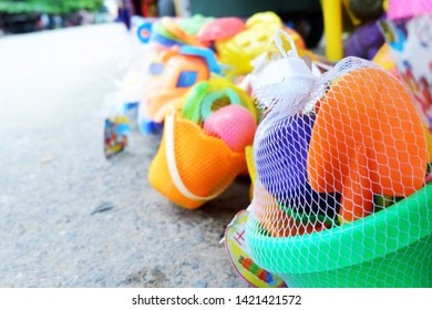 Picture of patio on the beach with sand digging tools toys in the summer season  blurred background - image