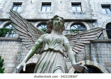 Picture of Patio statue of the angel inf front of the door castle porch beautiful gazebo designed - image