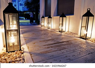 Picture of patio walkway wooden flooring lighting on the rock floor at night in the terrace down to the terrace of beautiful gazebo - image