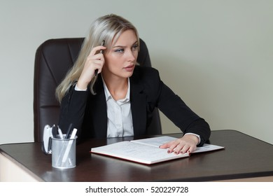 picture of pensive businesswoman with big notepad.
