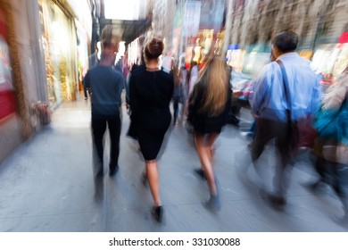 picture of people on the move in New York City at evening with intentional zoom and motion blur effect made by camera