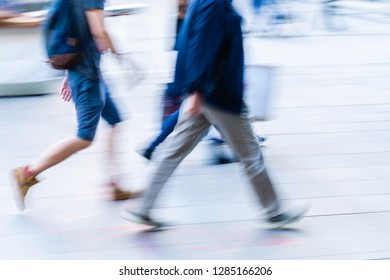 picture of people walking in the city in motion blur