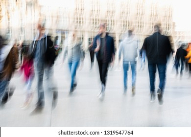 picture of people walking on a street in the city, with camera made motion blur effect