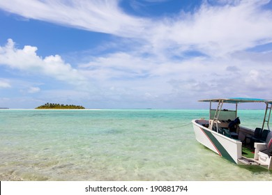 picture perfect view at the island, breathtaking lagoon and anchored boat at cook islands, aitutaki