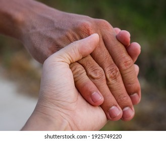 A picture of a person holding hands